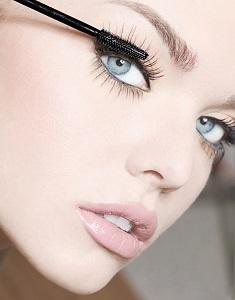 Woman Using Eyelash Serum
