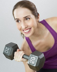 Smiling Woman Holding Dumbbell