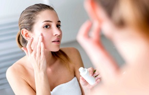 Woman Applying Wrinkle Serum